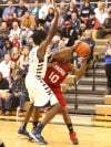 Portage's Timothy Bryant looks to pass around Michigan City's Anthony Simmons in the first half of Friday's Class 4A Valparaiso Sectional semifinals.