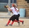 Portage's Kiley Jones catches a pup up bunt while teammate Alexis Johnson backs her up Saturday afternoon in semifinal play against Northridge at the Class 4A Harrison Semistate.