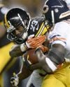Tillman banged up as Bears brace for Megatron