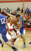 Washington Township's Alex Perez tries to get by Boone Grove's Kyle Kaminski on Thursday at the Porter County Conference tourney.