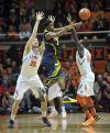 MEN'S BASKETBALL ROUNDUP: Michigan takes title with win at Illinois
