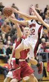 Washington Township junior Alex Perez shoots against Hebron junior Ryan Schmidt