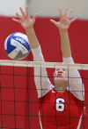 Munster's Elizabeth Kloos attempts a block during Wednesday's win at Andrean.