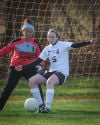 T.F. United's Callie Barnum clears the ball from the goal area as goalkeeper Lupida Arambula looks on during their match against Argo on Tuesday.