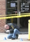 Two Gary men charged, cop shot in Hammond bank robbery