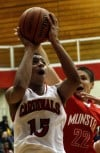 E.C. Central's Jeremiah Ochoa shoots around Munster's Drew Hachett