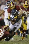 RG3 hurt, Seattle tops Redskins 24-14 in playoffs