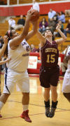 E.C. Central's Desiree DeGroot, left, and Chesterton's Caroline Puntillo battle for a rebound Tuesday.