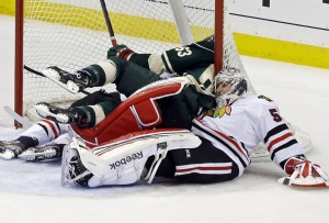 Sharp gets 2 goals as Hawks top Wild