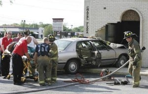 Car crashes through building