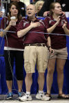 Chesterton coach Kevin Kinel reacts at the end of a race at the IHSAA state finals Saturday. The Trojans won the programs fourth title.