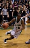 Illiana Christian's Brandon Martin dribbles down