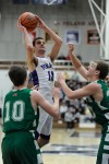 Merrillville's Jacob Raspopovich shoots over Valparaiso's defense Saturday night.