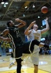 Valparaiso University's Kevin Van Wijk fights for a rebound with Chicago State's Jeremy Robinson