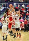 Crown Point's Katija Tarailo looks to shoot over LaPorte's Kelsey Gushrowski and Kate Ulmer, right, in the second half of Friday's Class 4A Hobart Sectional semifinals.