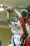 Bishop Noll's Larry Crisler tries to score against the Prairie Heights defense