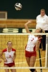 Crown Point's Alyssa Kvarta watches as teammate Meagan Fajman spikes