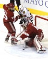 Phoenix's Mike Smith, Adrian Aucoin and Blackhawks Viktor Stalberg