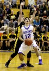 Boone Groves' Dean Hill looks to shoot against Kouts' Nick Taylor