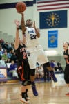 Merrillville junior forward Jaz Talley drives past LaPorte senior guard Jaclyn Health during Saturday night's Class 4A Hobart Sectional championship.