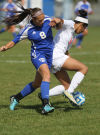 Lake Central's Brianna Dougherty and Munster's Savedy Majety get tangled up