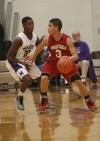 Merrillville's B.J. Jenkins guards Portage's Jordan Collazo on Friday.