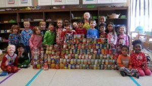 Tots learn by collecting food for church pantry