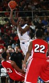 Lake Central's Tye Wilburn shoots against Morton's Travon Atkins on Friday.