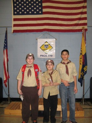 Webelos from East Side cross over to Boy Scouts