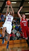 E.C. Central's Natisha Jones shoots past Munster's Jennifer Allen