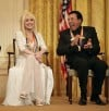"Singers Dolly Parton and William ""Smokey"" Robinson at the White House Sunday, Dec. 3, 2006"