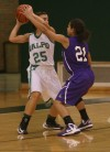 Valparaiso's Andi Sarkisian is pressured by Merrillville's Myranda Harris on Thursday.