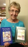 Author Mary Schuman Displays Her Two Indiana State Fair Recipe Cookbooks Co-Written with Her Sister Nancy Schuman