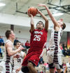 Portage's Canaan Cooper tries to shoot over Lowell's Eric Zukauskas