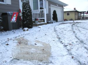 Car slides off road, narrowly misses house