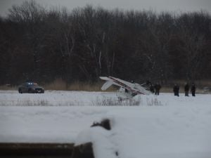 Plane flips on landing at Griffith-Merrillville Airport