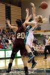 Chesterton's Hayley Sekula blocks a shot by Valparaiso's Grace Withrow in the first half Friday.