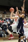 Crown Point's Josh Berqist goes up to shoot and draws a foul from Michigan City's Ryan Taylor on Thursday night.