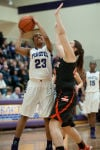Merrillville senior forward Riana Todd shoots as LaPorte sophomore center Jocelyn Colburn defends during Saturday's Class 4A Hobart Sectional title game.