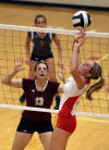 Chesterton's Brittany Milzarek watches as Crown Point's Alyssa Kvarta sets to a teammate