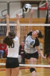 Lowell's Mallory Slavis goes up for a spike attempt against Highland's Kara Randall on Thursday at the Class 4A Munster Sectional.