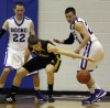 Kouts' Andrew Birky reaches for a loose ball while Boone Grove's Jon Hogg, left, and Daniel Malouhos defend