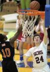 South Central senior Mark Richards shoots against Westville junior Josh Brownlee