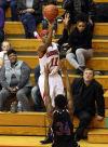 E.C. Central senior Hyron Edwards shoots over West Side senior Brian Fayson