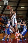 West Side players Jerrica Neal and Tinon Hunter go up for a rebound