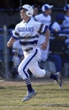 Lake Central's Alex Mantel scores in the second inning against Munster on Tuesday.
