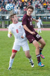 Crown Point senior Bay Kurtz, left, heads the ball as Chesterton senior Spase Dorsuleski attempts to block him during Saturday's Class 2A Merrillville Regional championship.