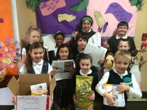 Lansing students collect for South Suburban Humane Society