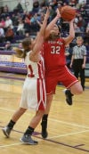 Portage's Kaitlin Doud drives against Crown Point's Hannah Albrecht during Tuesday night's opening round of the Class 4A Hobart Sectional.