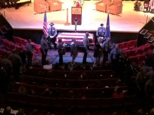 Crowds father for slain officer's funeral